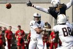 Murray State quarterback Preston Rice (5) throws during the first half of an NCAA college football game against Cincinnati, Saturday, Sept. 11, 2021, in Cincinnati. (AP Photo/Jeff Dean)