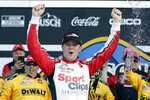 FILE - In this Feb. 9, 2020, file photo, Erik Jones celebrates in Victory Lane after winning the NASCAR Busch Clash auto race at Daytona International Speedway in Daytona Beach, Fla. The pandemic only accelerated the inevitable: The driver market bubble, pushed to its limit with multi-million dollar salaries for nearly two decades, is about to burst. A major reset has arrived and team owners have all the power. They can pick and choose between drivers who bring sponsorship dollars (Bubba Wallace) or drivers who have won races (Erik Jones). (AP Photo/John Raoux, FIlre)