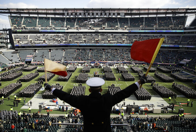 Navy Midshipman Frey Pankratz singles his classmates as they march onto the field ahead of an NCAA college football against the Army, Saturday, Dec. 8, 2018, in Philadelphia. (AP Photo/Matt Rourke)