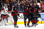 Carolina Hurricanes' Warren Foegele (13) is congratulated on his goal by teammates Andrei Svechnikov (37), of Russia, and Jake Gardiner (51) during the first period of an NHL hockey game against the Arizona Coyotes in Raleigh, N.C., Friday, Jan. 10, 2020. (AP Photo/Karl B DeBlaker)