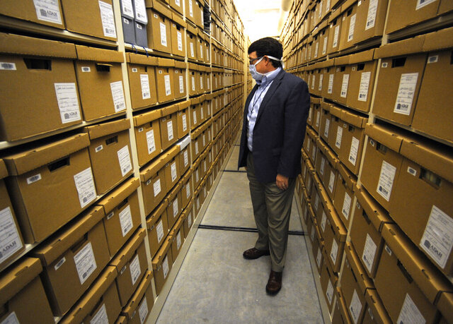 Steve Murray, director of the Alabama Department of Archives and History, looks through boxes containing archival materials in Montgomery, Ala., on Thursday, Aug. 13, 2020. Murray and other current leaders of the agency are confronting the early legacy of the department, which once embraced the