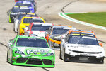 Kyle Busch, left, leads AJ Allmendinger right, as they come out of the first caution, Saturday, July 10, 2021, in Hampton, Ga. (AP Photo/John Amis)