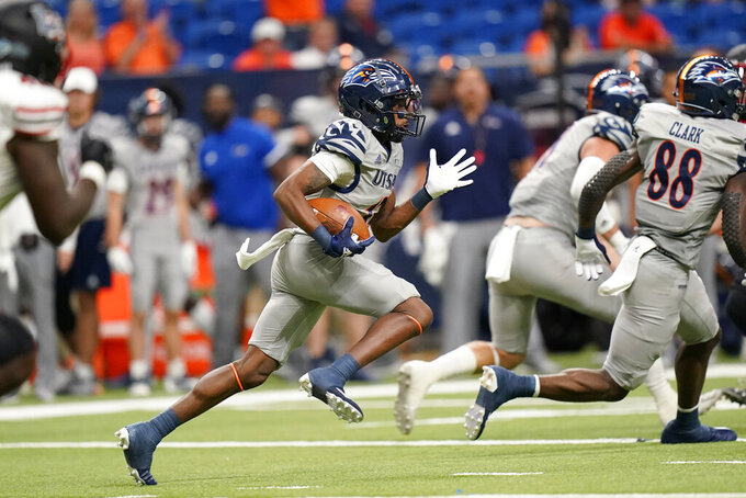 UTSA's Sheldon Jones (13) returns a punt for a touchdown against Lamar during the first half of an NCAA college football game Saturday, Sept. 11, 2021, in San Antonio. (AP Photo/Eric Gay)