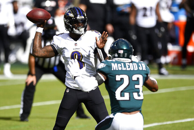 Baltimore Ravens' Lamar Jackson (8) tries to pass against Philadelphia Eagles' Rodney McLeod (23) during the first half of an NFL football game, Sunday, Oct. 18, 2020, in Philadelphia. (AP Photo/Derik Hamilton)