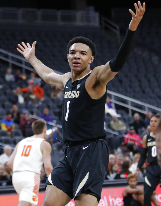 Colorado's Tyler Bey (1) celebrates after a play against Clemson during the second half of an NCAA college basketball game, Tuesday, Nov. 26, 2019, in Las Vegas. (AP Photo/John Locher)