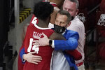 Alabama head coach Nate Oates hugs guard Keon Ellis (14) after beating Mississippi State 64-59 at an NCAA college basketball game in Starkville, Miss., Saturday, Feb. 27, 2021. With the win, Alabama captures the SEC regular season title. (AP Photo/Rogelio V. Solis)