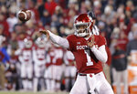 Oklahoma quarterback Kyler Murray (1) passes the ball against Kansas during the first half of an NCAA college football game in Norman, Okla., Saturday, Nov. 17, 2018. (AP Photo/Alonzo Adams)