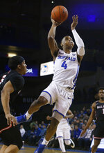 Buffalo guard Davonta Jordan (4) drives to the net against Ball State during the first half of an NCAA college basketball game Tuesday, Jan. 29, 2019, in Buffalo N.Y. (AP Photo/Jeffrey T. Barnes)