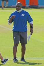 FILE-  In this Aug. 18, 2020, file photo, Miami Dolphins head coach Brian Flores looks on during an NFL football training camp practice in Davie, Fla. The Dolphins roster appears significantly upgraded by the draft and free agency, but the coronavirus pandemic curtailed offseason training. As a result, the Dolphins' 2020 season might be similar to 2019, when they were much better in December than in September. (AP Photo/Joel Auerbach File)