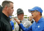 Northwestern coach Pat Fitzgerald, left, and Duke's David Cutcliffe, right, meet after their NCAA college football game Saturday, Sept. 8, 2018, in Evanston, Ill. (AP Photo/Jim Young)