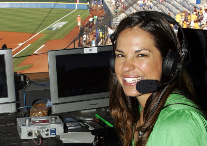 FILE - In this May 29, 2009, file photo, USA softball player Jessica Mendoza poses for a photo in the ESPN broadcast booth at the Women's College World Series in Oklahoma City. The dual roles of former Boston pitcher Pedro Martinez and ex-Olympic softball player Mendoza as team employees and broadcasters have drawn the concern of baseball Commissioner Rob Manfred. (AP Photo/File)