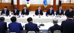 South Korean President Moon Jae-in, top center, speaks during a meeting with business leaders at the presidential Blue House in Seoul, South Korea, Wednesday, July 10, 2019. Moon criticized comments by Japanese officials who questioned the credibility of Seoul's sanctions against North Korea while justifying Tokyo's move to strengthen controls on high-tech exports to South Korea, which triggered a full-blown diplomatic dispute between the neighboring U.S. allies. (Bae Jae-man/Yonhap via AP)