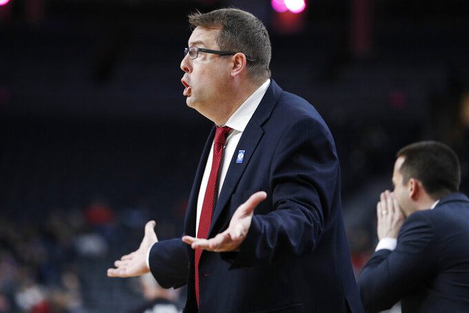 Stanford head coach Jerod Haase motions towards the court during the second half of an NCAA college basketball game against California in the first round of the Pac-12 men's tournament Wednesday, March 11, 2020, in Las Vegas. (AP Photo/John Locher)