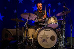 FILE - In this June 23, 2018 file photo, musician Ringo Starr performs in Tel Aviv, Israel. Within a week of Paul McCartney playing a surprise show at Grand Central Station, Starr followed a more old-fashioned path Thursday night, Sept. 13, 2018. The 78-year-old drummer and singer headlined a two-hour show at Radio City Music Hall, in New York, with thousands spending much of the performance standing and singing along. (AP Photo/Ariel Schalit, File)