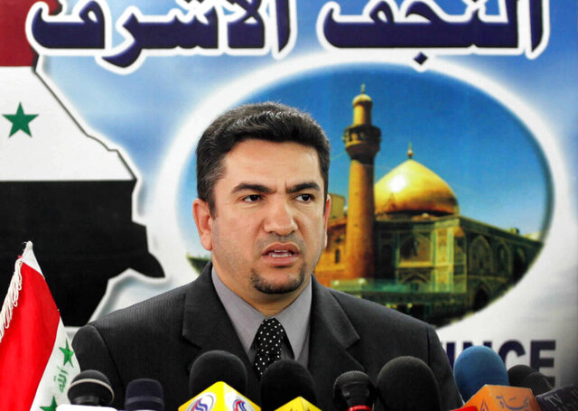 FILE - In this Feb. 5, 2005 file photo, then Governor of Najaf Adnan Al-Zurfi gives a news conference in Najaf, Iraq. On Tuesday, March 17, 2020, Iraq's president named Al-Zurfi as prime minister-designate, following weeks of political infighting and a looming crisis amid a global pandemic. His naming comes hours before a COVID-19 curfew is set to take hold in the capital, Baghdad, as Iraq struggles to contain the spread of the virus. For most people, the new coronavirus causes only mild or moderate symptoms. For some it can cause more severe illness  (AP Photo/Hadi Mizban, File)
