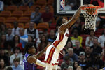Miami Heat forward Derrick Jones Jr. dunks the ball against Charlotte Hornets forward Jalen McDaniels (6) during the first half of an NBA basketball game, Wednesday, March 11, 2020, in Miami. (AP Photo/Wilfredo Lee)