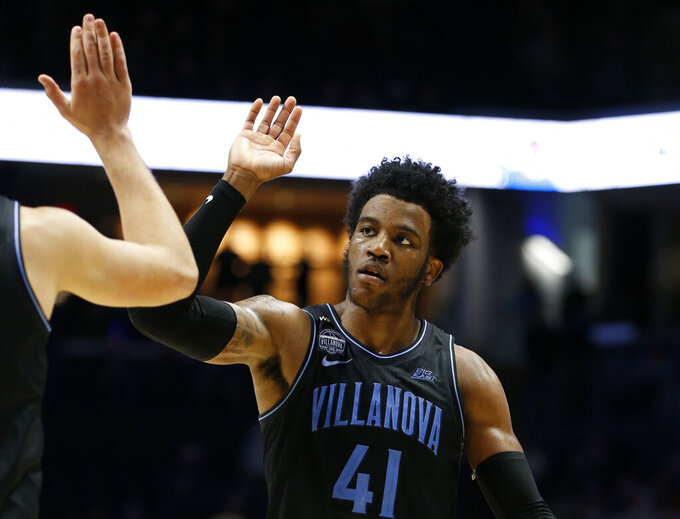 Villanova forward Saddiq Bey (41) celebrates the team's win over Xavier in an NCAA college basketball game, Saturday, Feb. 22, 2020, in Cincinnati. (AP Photo/Gary Landers)