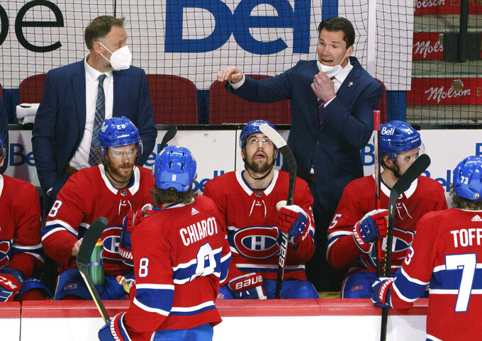 Montreal Canadiens replacement coach Luke Richardson gives instructions during a break in play against the Vegas Golden Knights during the second period of Game 4 in an NHL Stanley Cup playoff hockey semifinal in Montreal, Sunday, June 20, 2021. (Paul Chiasson/The Canadian Press via AP)
