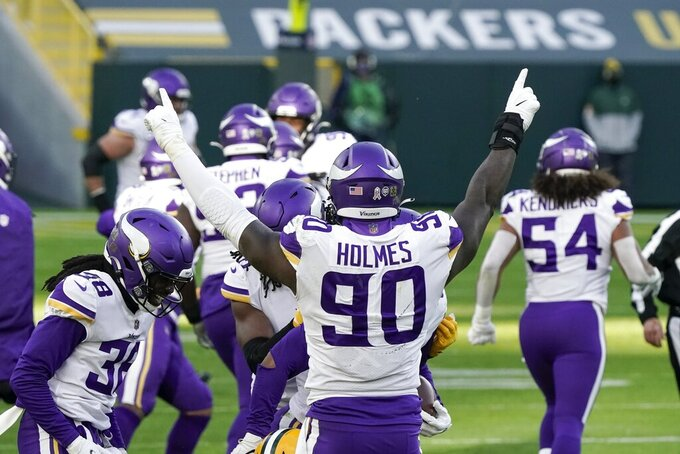 Minnesota Vikings' Jalyn Holmes reacts after the Vikings recovered a fumble during the second half of an NFL football game against the Green Bay Packers Sunday, Nov. 1, 2020, in Green Bay, Wis. (AP Photo/Morry Gash)