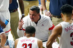 Arizona coach Sean Miller talks to the team during the second half of an NCAA college basketball game against Southern California, Thursday, Jan. 7, 2021, in Tucson, Ariz. (AP Photo/Rick Scuteri)