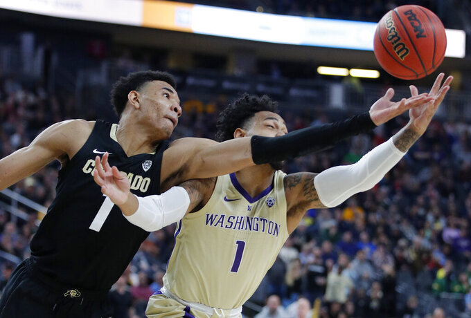 Colorado's Tyler Bey, left, an Washington's David Crisp battle for a rebound during the second half of an NCAA college basketball game in the semifinals of the Pac-12 men's tournament Friday, March 15, 2019, in Las Vegas. (AP Photo/John Locher)