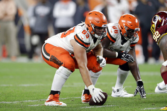 FILE - In this Aug. 8, 2019, file photo, Cleveland Browns center Austin Corbett (63) prepares to snap the ball during the second half of a preseason NFL football game against the Washington Redskins in Cleveland. The Browns traded Corbett on Tuesday, Oct. 15, 2019, to the Los Angeles Rams for an undisclosed 2021 draft pick(AP Photo/Ron Schwane)