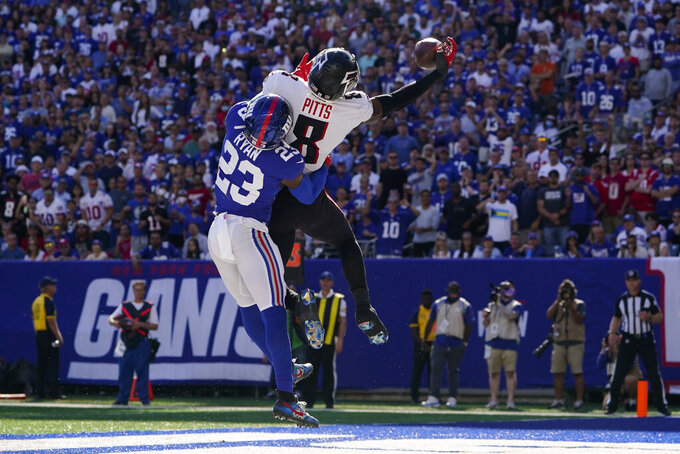 Atlanta Falcons tight end Kyle Pitts (8) misses a pass in the end zone against New York Giants cornerback Logan Ryan (23) during the second half of an NFL football game, Sunday, Sept. 26, 2021, in East Rutherford, N.J. (AP Photo/Seth Wenig)