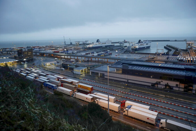 FILE - In this Saturday, Feb. 1, 2020 file photo, lorries wait to board ferries on the morning after Brexit took place at the Port of Dover, in Dover, England. The British government says there could be lines of 7,000 trucks at the English Channel and two-day waits to get into France immediately after the U.K. makes its economic break from the European Union at the end of the year. Brexit preparation minister Michael Gove describes that as a reasonable worst-case scenario in a letter to logistics firms. (AP Photo/Matt Dunham, FILE)