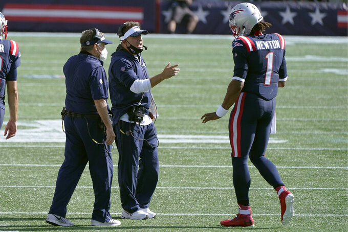 New England Patriots offensive coordinator Josh McDaniels, center, speaks to quarterback Cam Newton on the sideline in the second half of an NFL football game against the Miami Dolphins, Sunday, Sept. 13, 2020, in Foxborough, Mass. At left is head coach Bill Belichick. (AP Photo/Steven Senne)