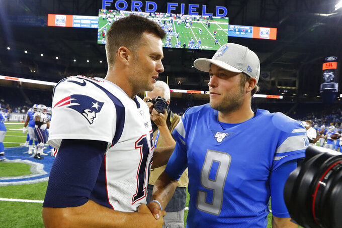 New England Patriots quarterback Tom Brady, left, greets Detroit Lions quarterback Matthew Stafford after a preseason NFL football game Thursday, Aug. 8, 2019, in Detroit. (AP Photo/Paul Sancya)