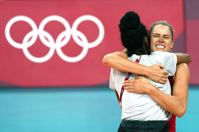 United States' Andrea Drews, rear, and United States' Jordan Thompson celebrate winning the women's volleyball preliminary round pool B match between United States and Italy at the 2020 Summer Olympics, Monday, Aug. 2, 2021, in Tokyo, Japan. (AP Photo/Frank Augstein)