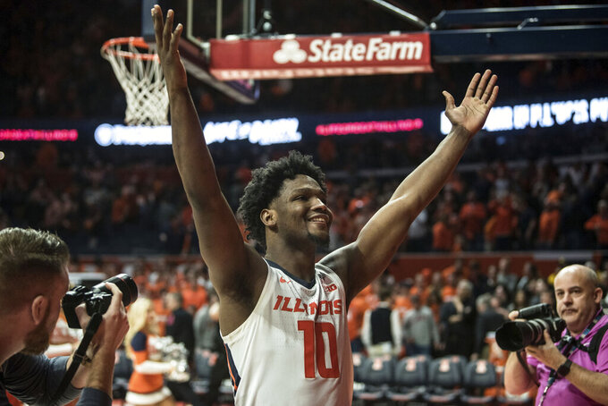 Illinois' Andres Feliz celebrates a victory over Iowa in an NCAA college basketball game, Sunday, March 8, 2020, in Champaign, Ill. (AP Photo/Holly Hart)