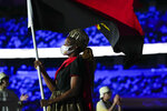 Natalia Santos of Angola, carry her country's flag during the opening ceremony in the Olympic Stadium at the 2020 Summer Olympics, Friday, July 23, 2021, in Tokyo, Japan. (AP Photo/Natacha Pisarenko)