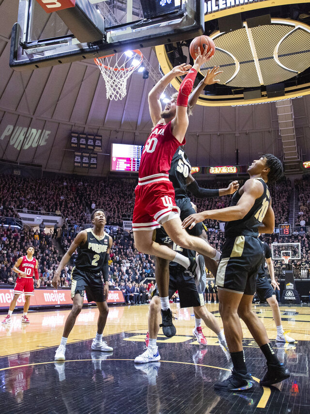 Indiana forward Joey Brunk (50) shoots at the basket as Purdue forward Trevion Williams (50) tries to block his shot during the first half of an NCAA college basketball game Thursday, Feb. 27, 2020, in West Lafayette, Ind. (AP Photo/Doug McSchooler)