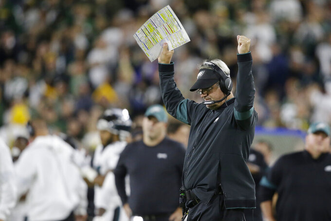 Philadelphia Eagles coach Doug Pederson celebrates after a replay ruling on the field confirmed a touchdown for the Eagles during the first half of an NFL football game against the Green Bay Packers on Thursday, Sept. 26, 2019, in Green Bay, Wis. (AP Photo/Jeffrey Phelps)