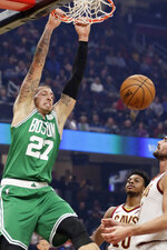 Boston Celtics' Daniel Theis dunks the ball against the Cleveland Cavaliers in the first half of an NBA basketball game, Tuesday, Nov. 5, 2019, in Cleveland. (AP Photo/Tony Dejak)