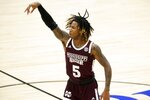 Mississippi State guard Deivon Smith (5) celebrates sinking a three-point basket during the second half of an NCAA college basketball game against Saint Louis in the first round of the NIT Tournament, Saturday, March 20, 2021, in Frisco, Texas. (AP Photo/Tony Gutierrez)
