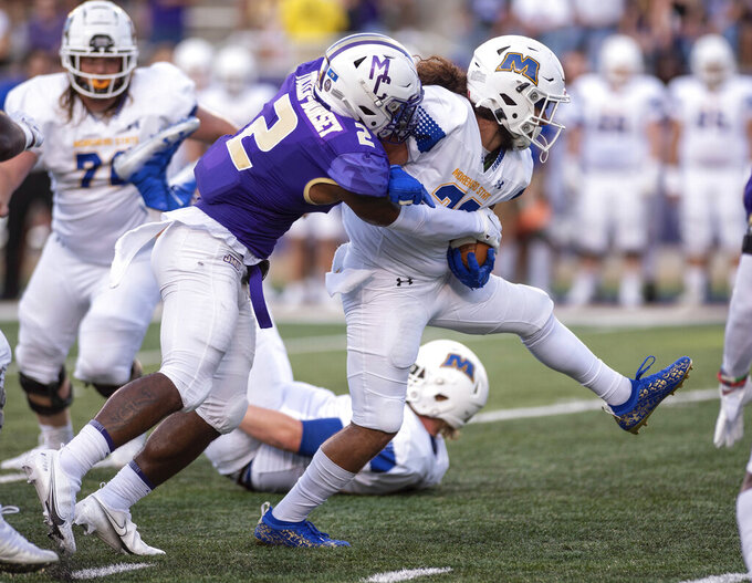 James Madison linebacker Diamonte Tucker-Dorsey (2) wraps up Morehead State running back Issiah Aguero (23) during the first half of an NCAA college football game in Harrisonburg, Va., Saturday, Sept. 4, 2021. (Daniel Lin/Daily News-Record via AP)
