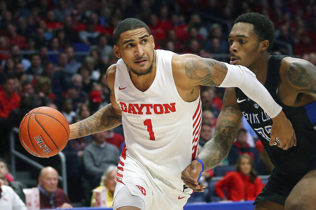 FILE - In this Feb 1, 2020, file photo, Dayton's Obi Toppin (1) drives to the basket against St. Louis forward Jimmy Bell Jr. (32) during the second half of an NCAA college basketball game in Dayton, Ohio. Toppin is a possible pick in the NBA Draft, Wednesday, Nov. 18, 2020.  (AP Photo/Tony Tribble, File)
