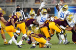 Arizona State's Christian Zendejas, left, misses on a field-goal attempt against UCLA during the first half of an NCAA college football game Saturday, Dec. 5, 2020, in Tempe, Ariz. (AP Photo/Matt York)