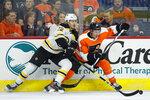 Boston Bruins' Peter Cehlarik, left, and Philadelphia Flyers' Justin Braun vie for the puck during the second period of a preseason NHL hockey game Thursday, Sept. 19, 2019, in Philadelphia. (AP Photo/Matt Slocum)