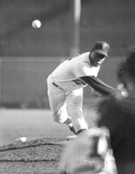 """FILE - In this Oct. 13, 1965, file photo, Minnesota Twins' Jim """"Mudcat"""" Grant, Minnesota Twins throws during the early innings of the Game 6 in baseball's World Series at Metropolitan Stadium in Minneapolis. Grant, the first Black 20-game winner in the major leagues and a key part of Minnesota's first World Series team in 1965, has died, the Twins announced Saturday, June 12, 2021. He was 85. (AP Photo/File)"""
