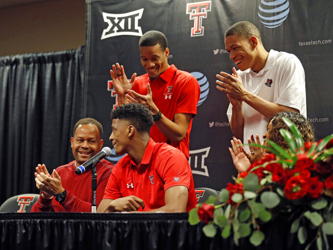Texas Tech's Jarrett Culver, center front, publicly declares to enter the NBA basketball draft while surrounded by his family during a news conference, Thursday, April 18, 2019, in Lubbock, Texas. (Brad Tollefson/Lubbock Avalanche-Journal via AP)