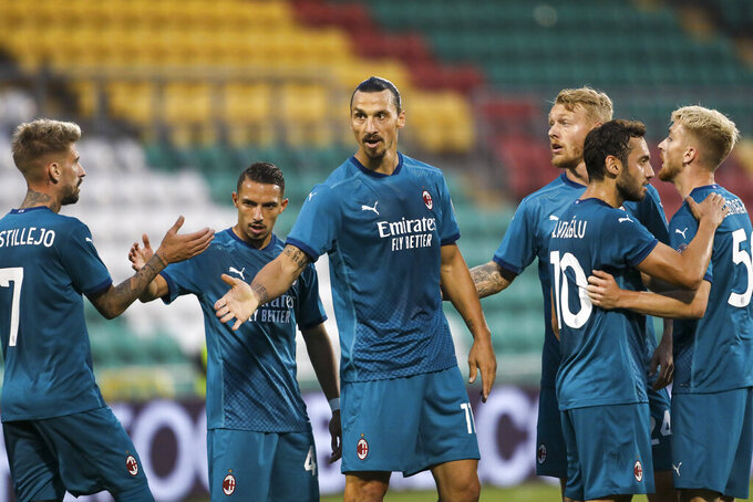 AC Milan's Zlatan Ibrahimovic, center, celebrates with his teammates after he scored his side's first goal during an Europa League second qualifying round soccer match between Shamrock Rovers and AC Milan at the Tallaght Stadium in Dublin, Thursday, Sept. 17, 2020. (AP Photo/Peter Morgan)