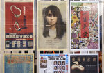 Layouts of Apple Daily are displayed outside the office of an editor at the news room Monday, April 26, 2021, in Hong Kong. The Apple Daily editors and executives were detained Thursday, June 17, under a national security law that took effect last year. (AP Photo/Vincent Yu)