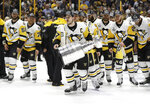 FILE - In this June 11, 2017, file photo, Pittsburgh Penguins' Sidney Crosby (87) celebrates with the Stanley Cup after defeating the Nashville Predators in Game 6 of the NHL hockey Stanley Cup Final, in Nashville, Tenn. If a Game 7 had been needed to determine the Stanley Cup champion, the NHL season could have had a win-it-all finale 0n May 27, 2020. St. Louis won its first title in a seven-game series last year against the Boston Bruins, who had won the last seven-game Stanley Cup, in 2011 over Vancouver. (AP Photo/Mark Humphrey, File)