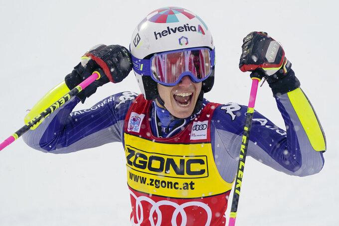 Italy's Marta Bassino celebrates winning an alpine ski, women's World Cup giant slalom in Courchevel, France, Saturday, Dec. 12, 2020. (AP Photo/Giovanni Auletta)