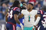 Miami Dolphins quarterback Tua Tagovailoa (1) talks with New England Patriots outside linebacker Dont'a Hightower (54) after an NFL football game, Sunday, Sept. 12, 2021, in Foxborough, Mass. (AP Photo/Steven Senne)