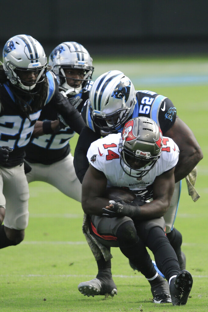 Carolina Panthers middle linebacker Tahir Whitehead (52) hits Tampa Bay Buccaneers wide receiver Chris Godwin (14) vduring the first half of an NFL football game, Sunday, Nov. 15, 2020, in Charlotte , N.C. (AP Photo/Brian Blanco)