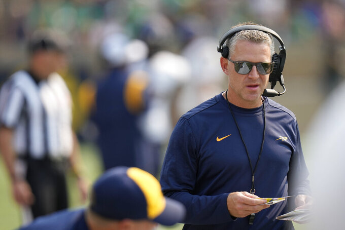 Toledo head coach Jason Candle roams the sideline before the second half of an NCAA college football game against Notre Dame in South Bend, Ind., Saturday, Sept. 11, 2021. Notre Dame won 32-29. (AP Photo/AJ Mast)